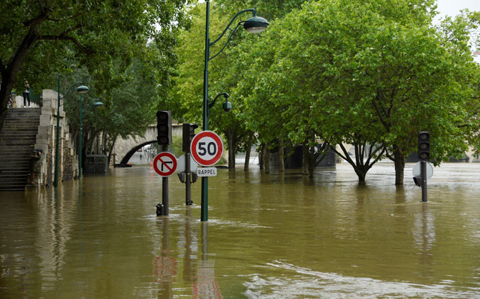 A photo taken on June 2, 2016 shows the flooded banks of the river Seine in Paris. Torrential downpours have lashed parts of northern Europe in recent days, leaving four dead in Germany, breaching the banks of the Seine in Paris and flooding rural roads and villages. Picture: AFP.