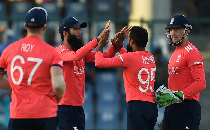 Englands Adil Rashid (2R) celebrates with teammates after taking the wicket of Afghanistans Mohammad Nabi during the World T20 cricket tournament match between England and Afghanistan at The Feroz Shah Kolta Cricket Stadium in New Delhi on March 23, 2016. Picture: AFP