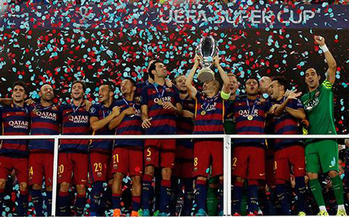 Barcelona players celebrate with the trophy after winning the European Super Cup with a 5-4 win over Sevilla on 11 August 2015. Picture: Barcelona/Facebook.