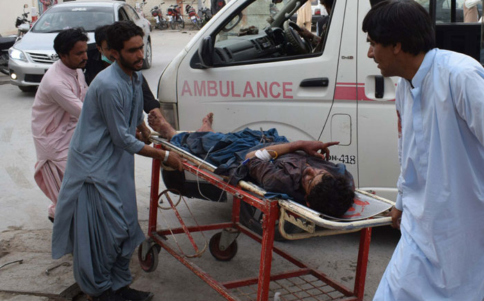 A victim of a bomb blast is brought to a hospital in Quetta on 13 July, 2018 following an attack at an election rally. Picture: AFP