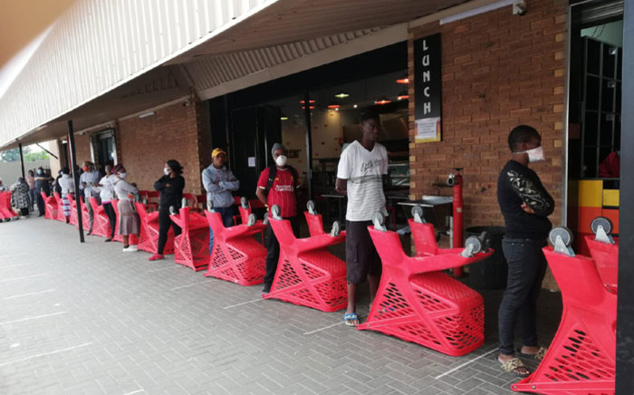 FILE: Social distancing is enforced at a shopping centre where social grant recipients are collecting their payouts on 30 March 2020. Picture: @The_DSD/Twitter