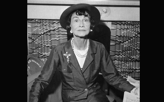 In this file photo taken on 1 January 1960, French fashion designer Coco Chanel poses onboard of a plane at Paris airport. She died on 10 January 1971, at the Hotel Ritz, in Paris, at the age of 87. Picture: AFP.
