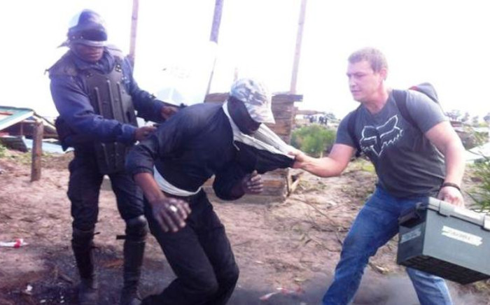 Some protesters in the Marikana informal settlement were arrested on 22 August 2014. Picture: Siyabonga Sesant/EWN.