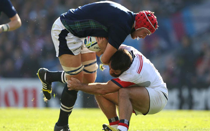 United States' Phil Thiel has his hands full trying to pull down Grant Gilchrist. Picture: Rugbyworld.com