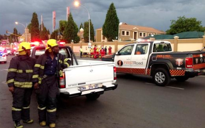 Emergency services officials wait outside Radovan Krejcir's Money Point shop in Bedfordview where an explosion occurred on 12 November 2013. Picture: Mandy Wiener/EWN.