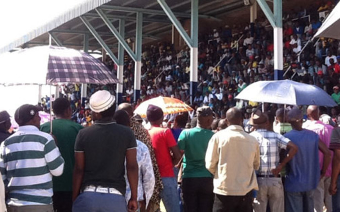 Miners gather at the Wonderkop Stadium in Marikana, amid a heavy police presence. Picture: Gia Nicolaides/EWN