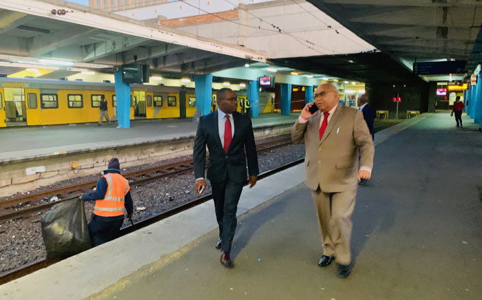 Transport and Public Works MEC Bonginkosi Madikizela (left) and Western Cape Community Safety MEC Albert Fritz (right) inspect the Cape Town train station on 29 May 2019 after two train coaches were destroyed in a fire. Picture: @NMakoba/spokesperson to MEC Madikizela.
