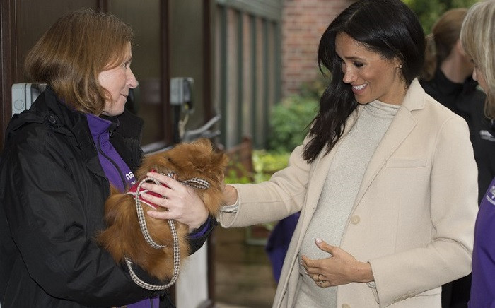"""Meghan, Duchess of Sussex meets a dog named """"Foxy"""" during her visit to the animal welfare charity Mayhew in London on 16 January 2019. Picture: AFP"""