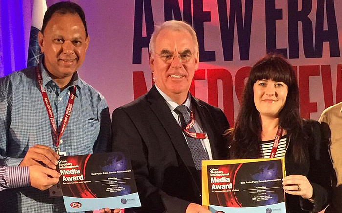 Crime Line SA's Yusuf Abramjee and Marisa Oosthuizen are handed the awards by Crime Stoppers International President, Alexander MacDonald (C). Picture: @Abramjee via Twitter.