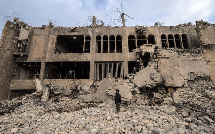 An Iraqi stands on the rubble of the destroyed seven-storey Chadirji Building, designed by celebrated Iraqi architect Rifat Chadirji in the 1960s, on 13 January, 2019, in the city of Mosul. Authorities in Mosul have begun demolishing a onetime icon of modern Iraqi architecture used by the Islamic State group to throw men accused of being gay to their deaths. Picture: AFP.