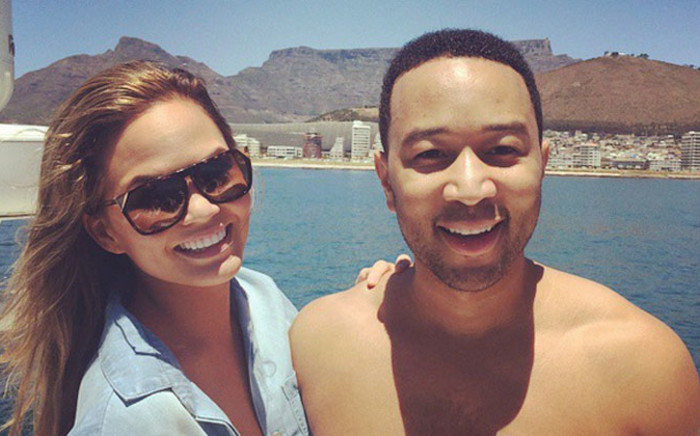 "American musician, John Legend poses with his wife, Chrissy Teigen, during his ""All of me"" tour in South Africa. Picture: John Legend via Instagram"