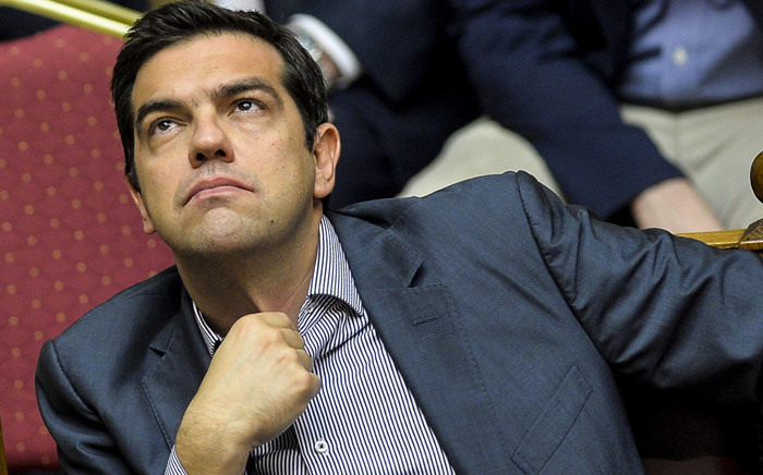 Greek Prime Minister Alexis Tsipras takes part in a session at the Greek Parliament in Athens on 10 July 2015. Picture: AFP.