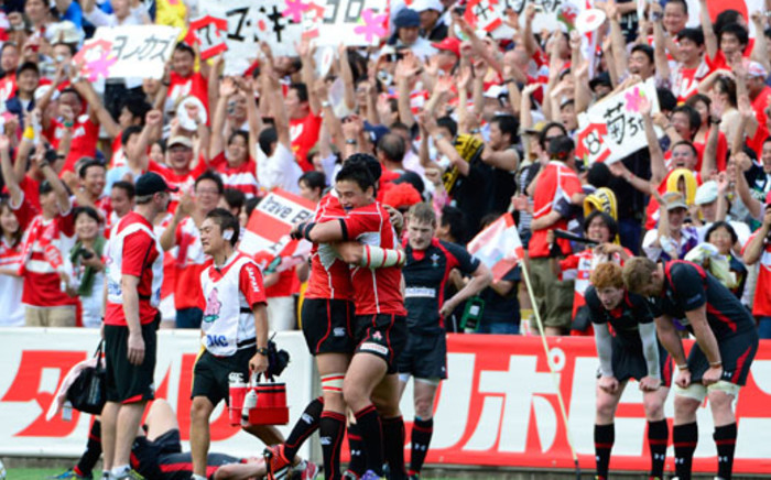 Japanese full back Ayumu Goroumaru (C/R/facing) celebrates with his teammates after the team won their test match against Wales in Tokyo on 15 June 2013. Picture: AFP/Toru YAMANAKA