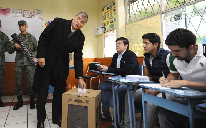 Ecuador's President Rafael Correa casts his vote at the San Francisco school, during the presidential runoff election, in Quito, on April 2, 2017. Ecuadorans headed to the polls in a presidential runoff that will turn the page on a decade under leftist Rafael Correa and decide whether the nation follows Latin America's rightward shift, facing socialist president's designated heir, Lenin Moreno, in a tight contest with conservative ex-banker Guillermo Lasso. Picture: AFP