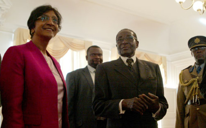 UN High Commissioner for Human Rights Navi Pillay (L) poses with Zimbabwean President Robert Mugabe (2nd R) on May 23, 2012 at the State House in Harare. Picture: AFP