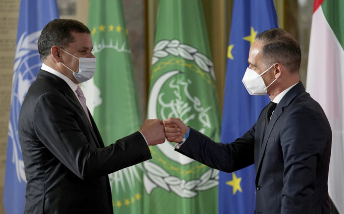 German Foreign Minister Heiko Maas (R) welcomes Libyan Prime Minister Abdul Hamid Dbeibah for the Second Berlin Conference on peace in Libya at the German Foreign Ministry in Berlin on 23 June 2021. Picture: Michael Sohn/POOL/AFP
