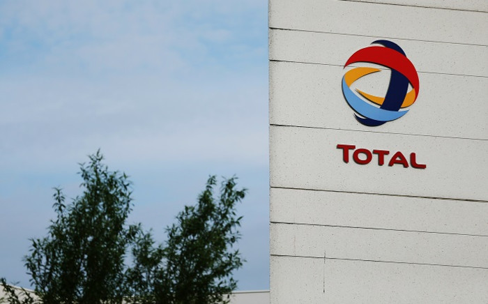 FILE: A picture taken on 23 May 2016 in Gonfreville-l'Orcher, northwestern France shows the logo of the Total refinery. Picture: AFP