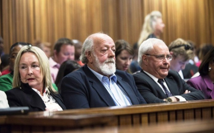 June (L) and Barry Steenkamp (C), Reeva Steenkamp's parents, attend the concluding arguments at the Pretoria High Court on 7 August 2014. Picture: AFP.