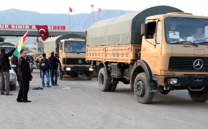 Peshmerga on their way to Kobani arrive at the Habur gate crossing on the Turkey-Iraq border. Picture: EPA.