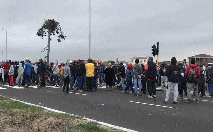 More than 200 residents have taken to the streets in anger, demanding land and housing. Picture: Kaylynn Palm/EWN.