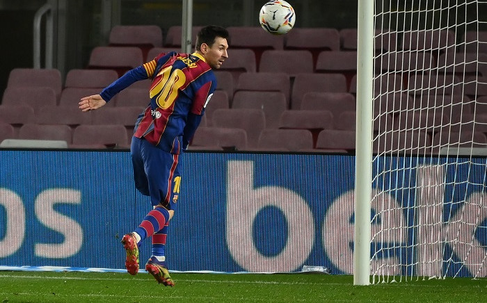 Barcelona's Argentinian forward Lionel Messi jumps for the ball during the Spanish league football match between FC Barcelona and Levante UD at the Camp Nou stadium in Barcelona on December 13, 2020. Picture: AFP