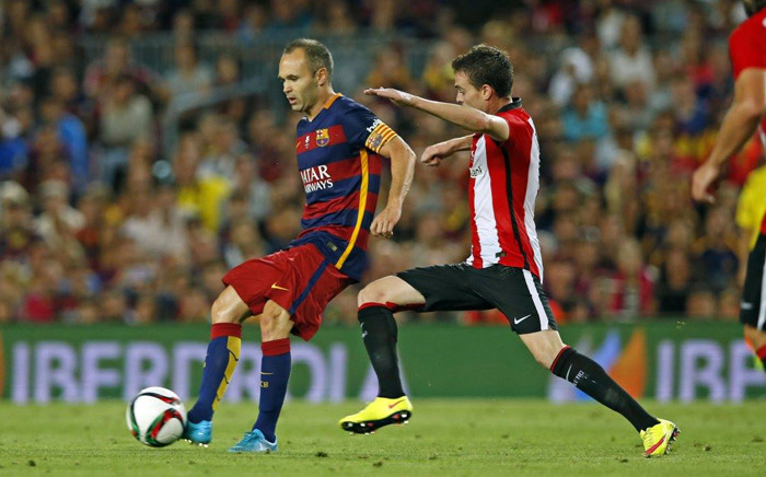 Barcelona's Andres Iniesta is marked by Athletico Bilbao player during their Spanish Super Cup final on 17 August 2015. Picture: Barcelona/Facebook.