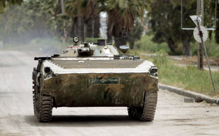 FILE: A Syrian army tank patrols an area in the district of Al-Waar in the flashpoint city of Homs. Picture: AFP