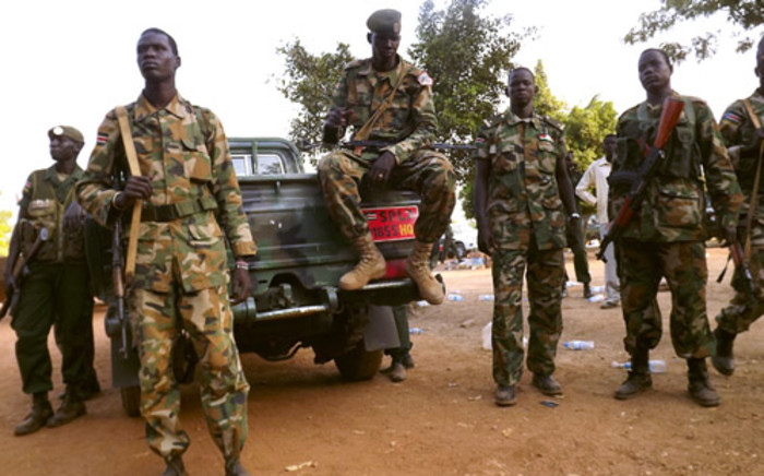 FILE: A group of South Sudanese soldiers gather near a truck as they patrol the streets of Juba on 2 January, 2014. Picture: AFP.