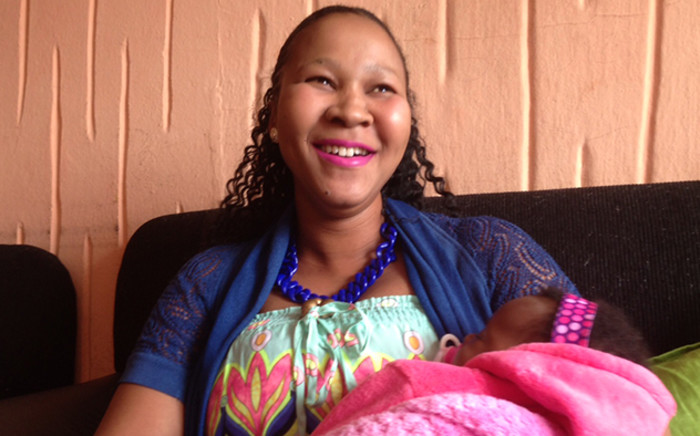 Lindiwe Ndwandwe a survivor of the TB Joshua church building collapse and her one month-old baby Minenhle. Picture: Vumani Mkhize/EWN.