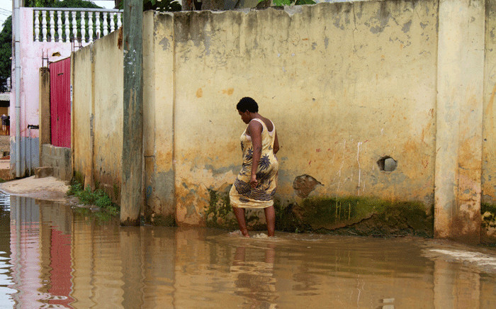 A resident walks in floodwater in the Futungo District in Luanda, Angola, on April 20, 2021, after the heavy rains on April 19, 2021. Flash floods triggered by torrential rains killed 14 people and displaced around 8,000 others in the Angolan capital Luanda on April 19, 2021 the national news agency has reported. Picture: Osvaldo Silva / AFP