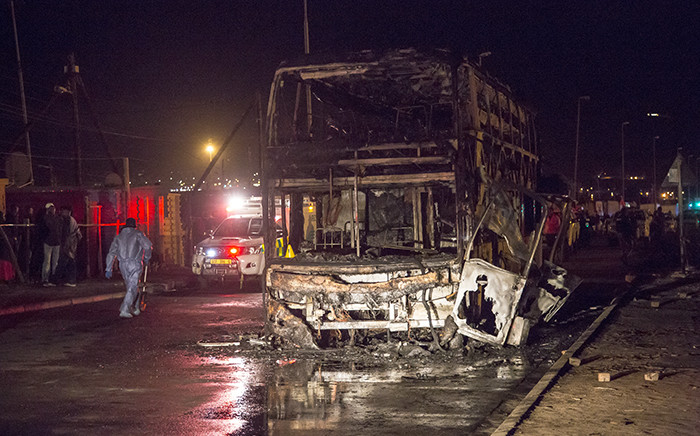An InterCape bus was petrol bombed in Strand with its 35 passengers on board. Two died in the blaze. Picture: Thomas Holder/EWN