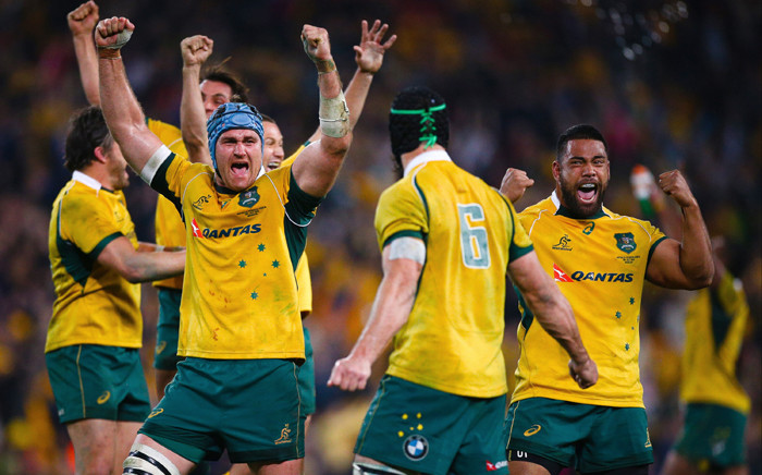 James Horwill (L) of Australia celebrates with teammates after their victory during the Rugby Championship Test match between Australia and South Africa at Suncorp Stadium in Brisbane on 18 July, 2015. Picture: AFP.