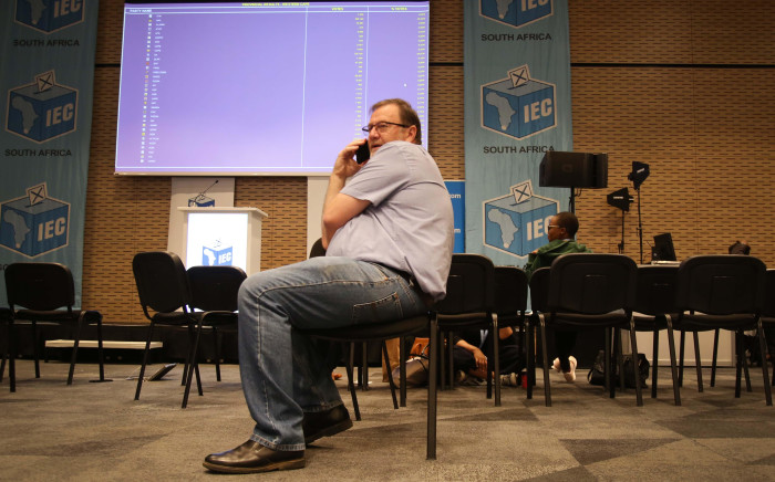 FILE: The DA's Anton Bredell sits in front of the results board at the IEC Results Centre in Cape Town. Picture: Bertram Malgas /EWN