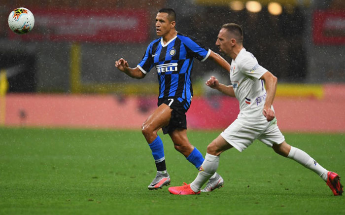 Inter Milan's Alexi Sanchez and Fiorentina's Franck Ribery chase after the ball during their Serie A match on 22 July 2020. Picture: @Inter_en/Twitter
