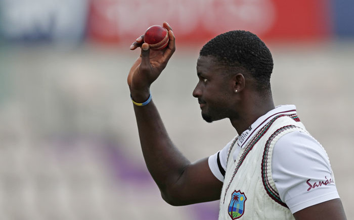 West Indies' Jason Holder leaves the field with the ball after taking six wickets to help bowl out England for 204 runs in the first innings on the second day of the first Test cricket match between England and the West Indies at the Ageas Bowl in Southampton, southwest England on 9 July 2020. Picture: AFP