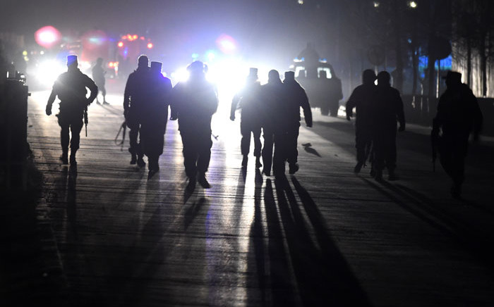 Afghan security personnel arrive at the site of twin blasts near the Afghan parliament in Kabul on January 10, 2017. Picture: AFP