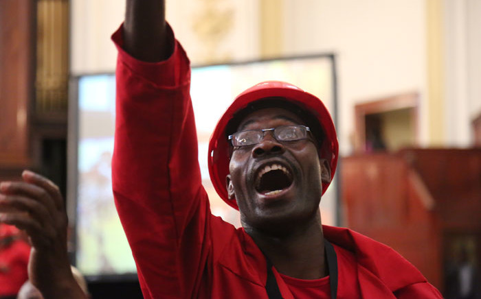 An EFF City of Johannesburg council member gestures in the Johannesburg City Hall. Picture: Christa Eybers/EWN.