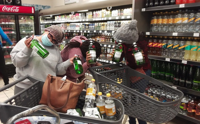 FILE: Shoppers pose with their alcohol after the liquor sales ban was lifted on 1 June 2020. Picture: Supplied