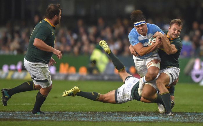 South Africa's tighthead prop Frans Malherbe (L) looks on as Argentina's flanker Pablo Matera (2R) is tackled by South Africa's inside centre Andre Esterhuizen(R) and full-back Willem le Roux (C) during The Rugby Championship rugby union match between South Africa and Argentina at Johnson Kings Park Stadium in Durban on 18 August 2018. Picture: AFP
