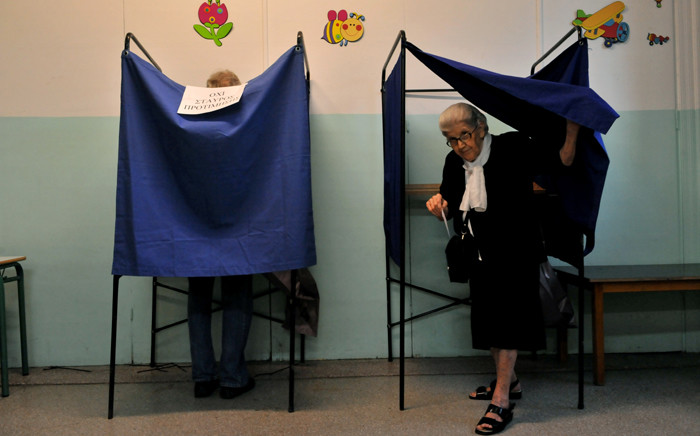 An elderly woman leaves the voting booth in a polling station in Thessaloniki, on 20 September, 2015. Picture: AFP.