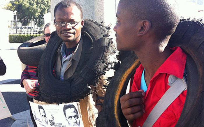 Protesters highlight the ongoing cases on mob justice in Khayelitsha on Mandela Day. Picture: Graeme Raubenheimer/EWN