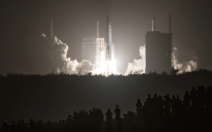 A Long March 5 rocket carrying China's Chang'e-5 lunar probe launches from the Wenchang Space Center on China's southern Hainan Island on November 24, 2020, on a mission to bring back lunar rocks, the first attempt by any nation to retrieve samples from the moon in four decades. Picture: AFP.
