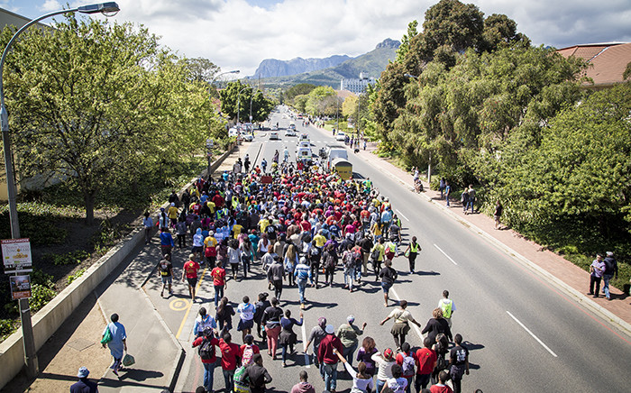 """FILE: Members of Sasco march towards Stellenbosch University's campus to deliver a memorandum on transformation during a protest. Picture: Thomas Holder/EWN"""""""