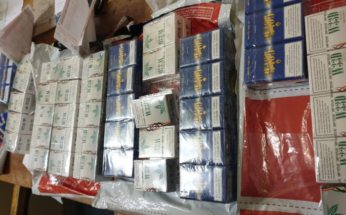 Police confiscate illicit cigarettes valued at R122,000 destined for the black market on 12 May 2020. Image: SAPS