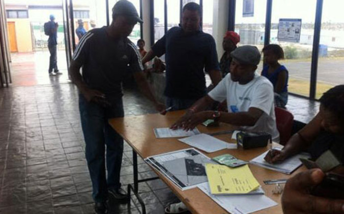 IEC officials say about 100 people have registered at Mew Way Hall in Khayelitsha so far. Picture: Siyabonga Sesant/EWN.