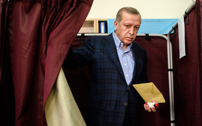 Turkish President Recep Tayyip Erdogan exits a voting booth at a polling station in Istanbul on 1 November 2015. Picture: AFP.