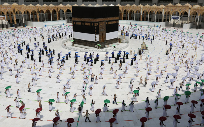 A picture taken on 29 July 2020 shows pilgrims circumambulating around the Kaaba, Islam's holiest shrine, at the centre of the Grand Mosque in the holy city of Mecca, at the start of the annual Muslim Hajj pilgrimage. Picture: AFP