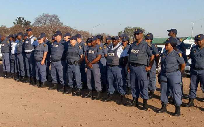 Tshwane police assemble at the old Putco depot in Marabastad on 8 November 2017 as they prepare to deal with a taxi strike. Picture: @SAPoliceService/Twitter