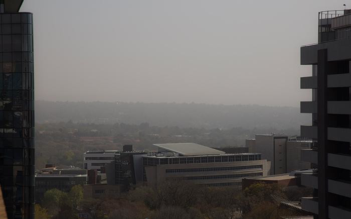 A sand storm moves towards Sandton on 22 August 2017.  Picture: Christa Eybers/EWN.