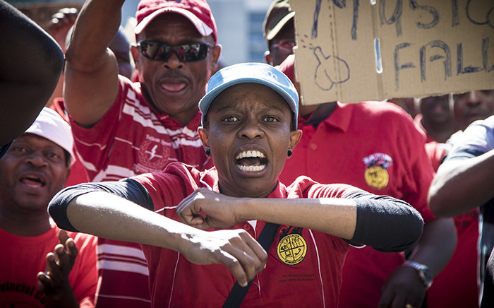 The demonstrators from the Communication Workers Union making their way to the Johannesburg Stock Exchange to hand over a memorandum of demands. Picture: Thomas Holder/EWN.
